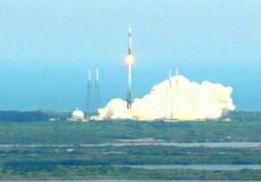 Rocket blasts off with missile-warning satellite.