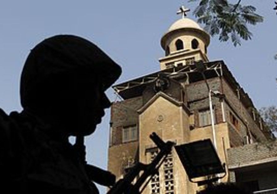 A soldier stands guard outside an Egyptian church