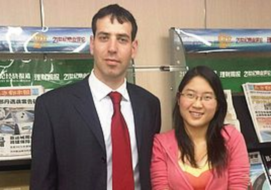 Israeli businessman Gil Kerbs & a Chinese reporter