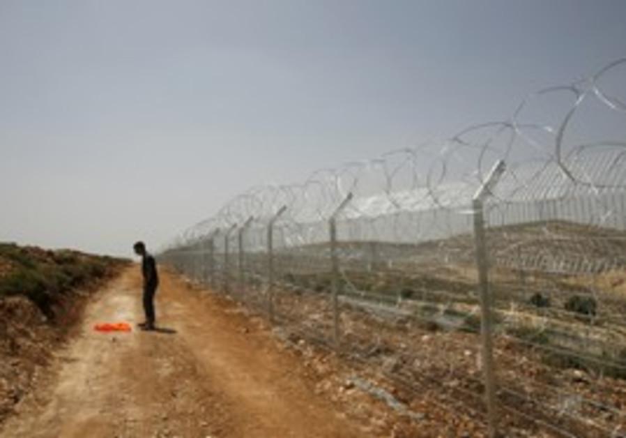 Security fence near Jerusalem [illustrative]