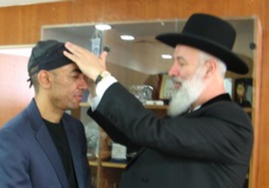 Mark Obama Ndesandjo with Rabbi Metzger