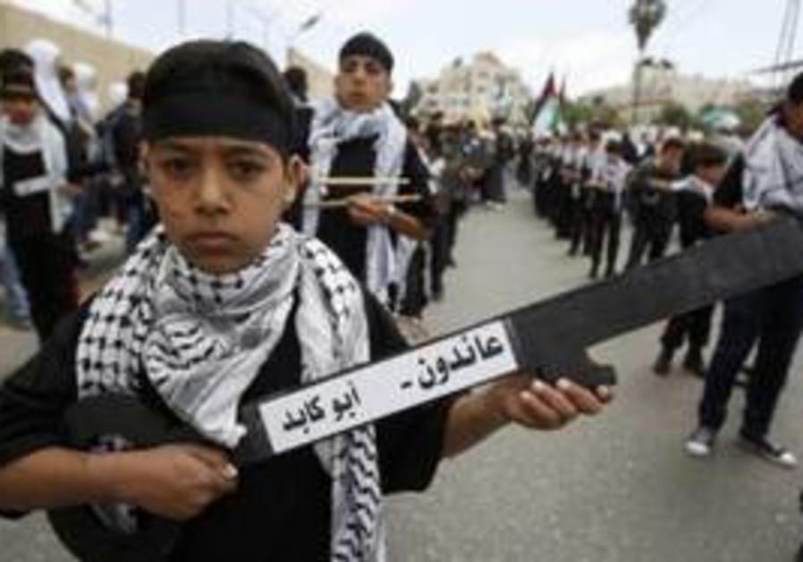 Palestinian boys holding symbolic keys in Ramallah