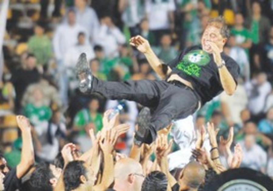 Maccabi Haifa coach Elisha Levy celebrates title