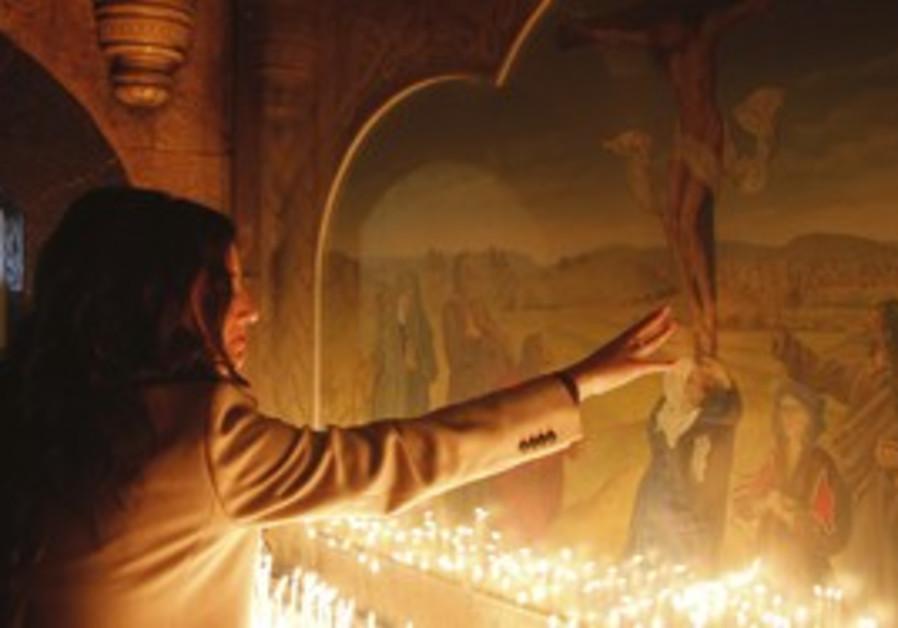 A Christian woman at a church in Damascus.