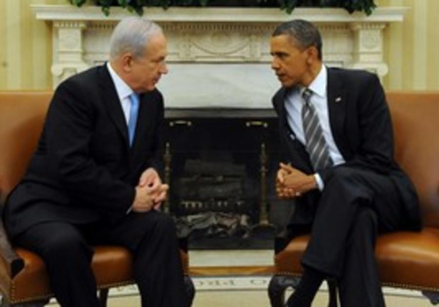 PM Netanyahu sitting with US President Obama