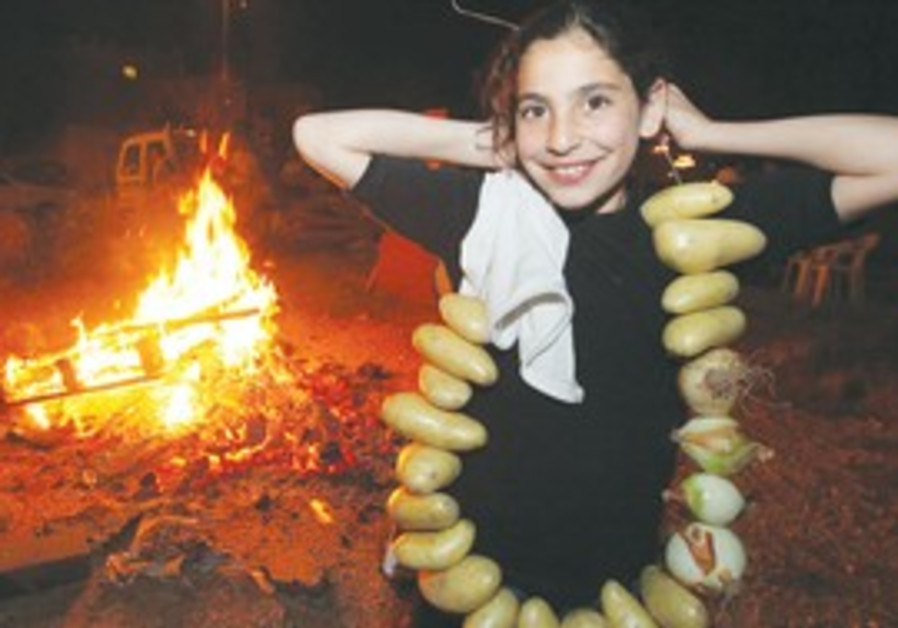 A GIRL gets set to roast a string of potatoes