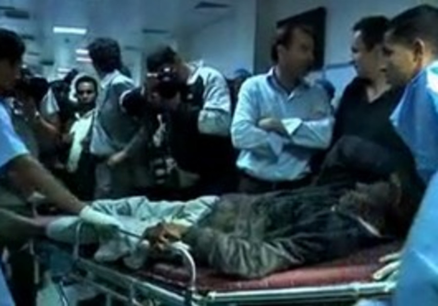 Injured Libyans at hospital after NATO strikes.