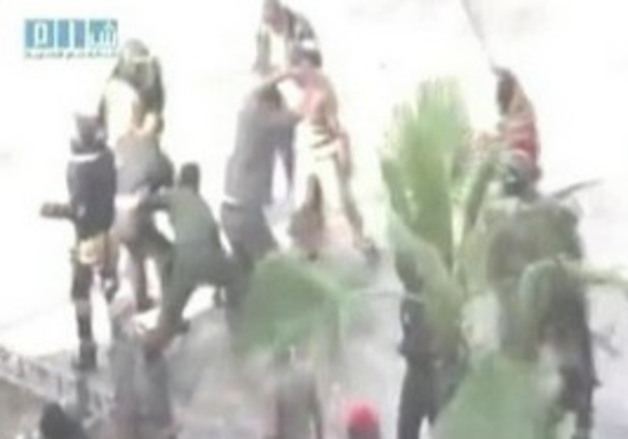 Syrian security forces beat protesters in Hama.