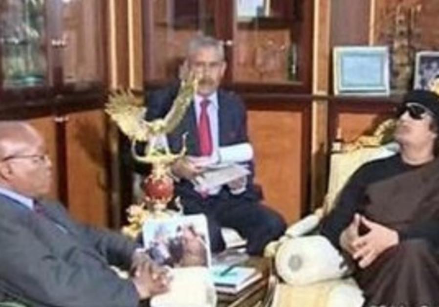Jacob Zuma and Muammar Gaddafi meet in Libya.
