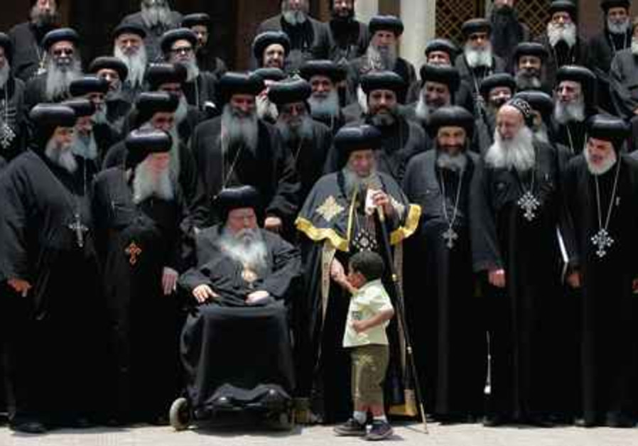 Egyptian Copts. Pope Shenouda (center).