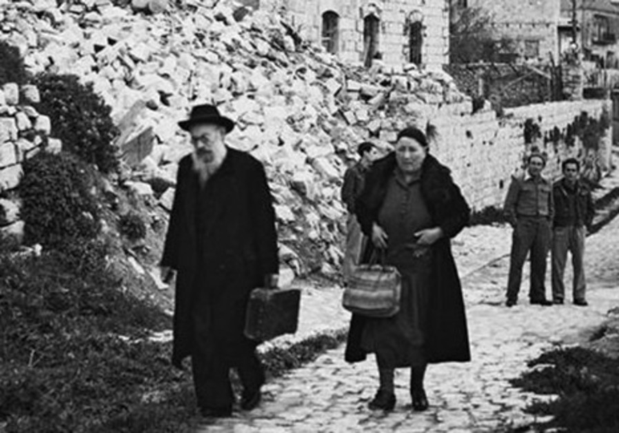 Photo shows Jews leaving destroyed home in 1948.