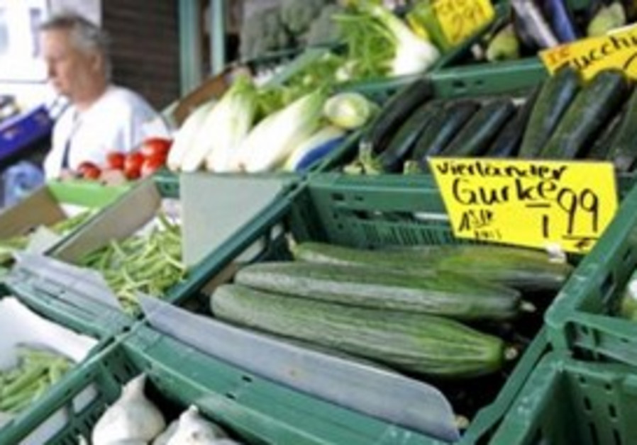 Vegetables are offered at a greengrocer's shop