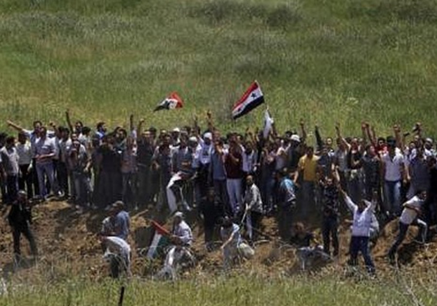 Palestinians protest on the Syrian-Israeli border.