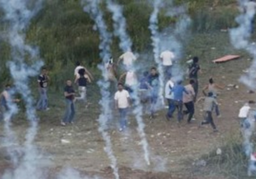 Syrian Naksa Day protesters run from tear gas
