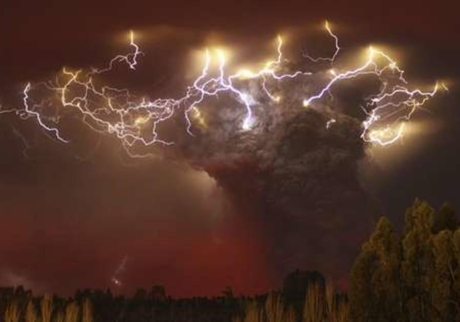 Lightning flashes around the ash plume