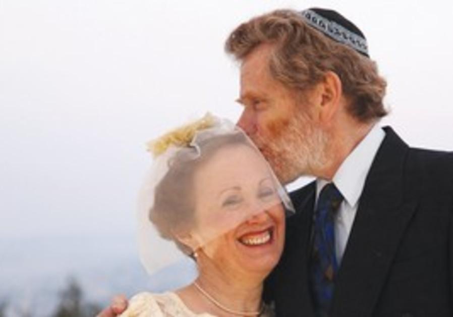 Groom Sheldon Fossaner kisses the bride, the 'Post