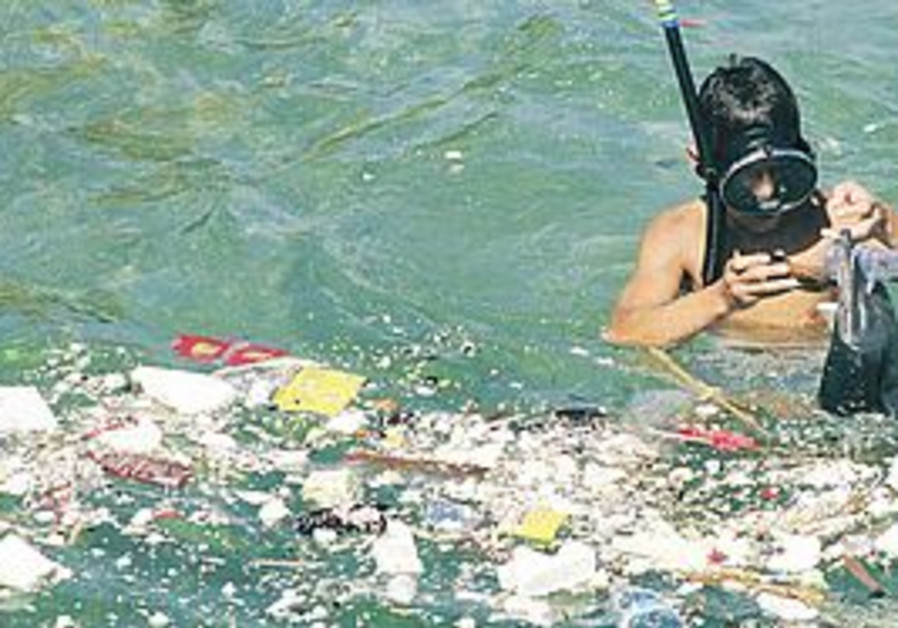 A diver removes garbage from the Mediterranean.