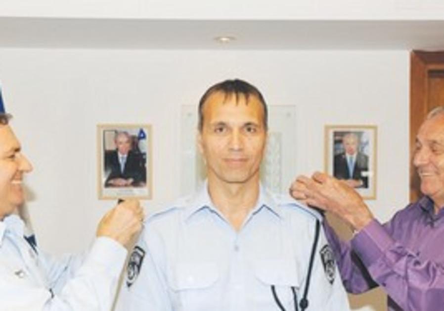HILLEL PARTUK receives his new rank