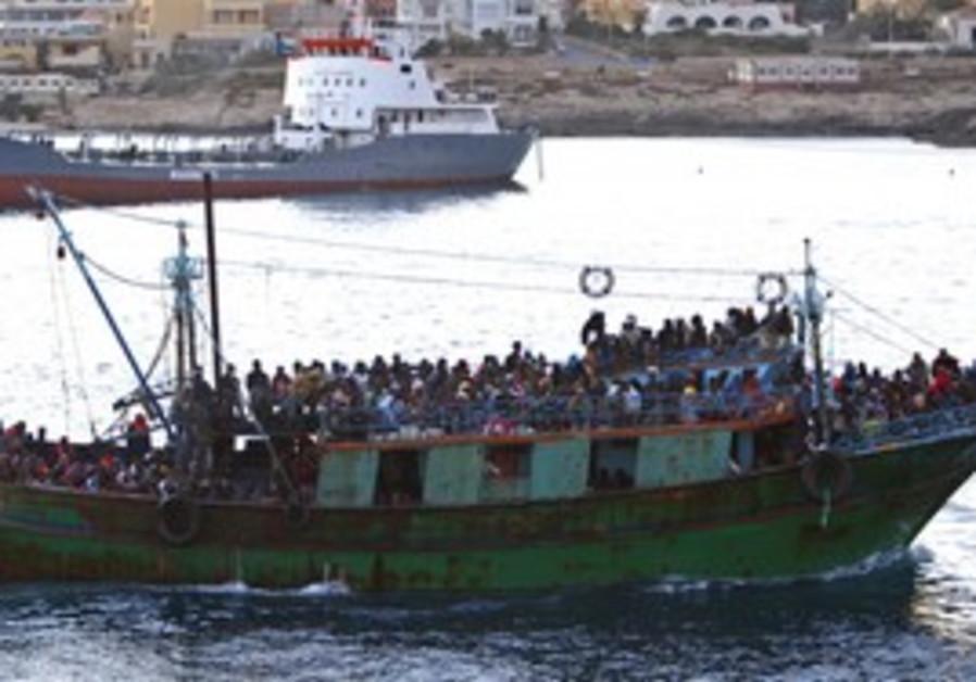 A migrant boat arrives in Lampedusa, April.