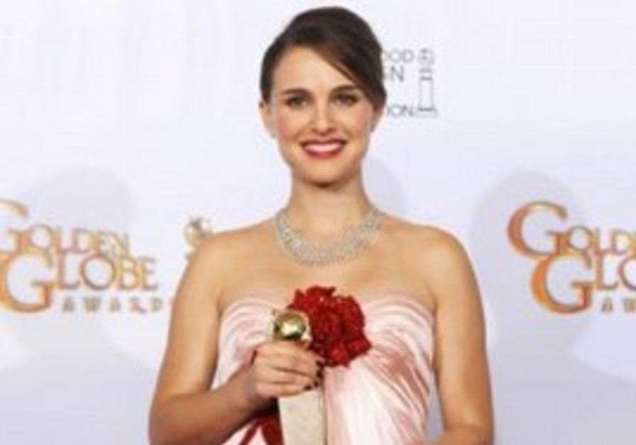 Actress Natalie Portman poses with her Golde Globe