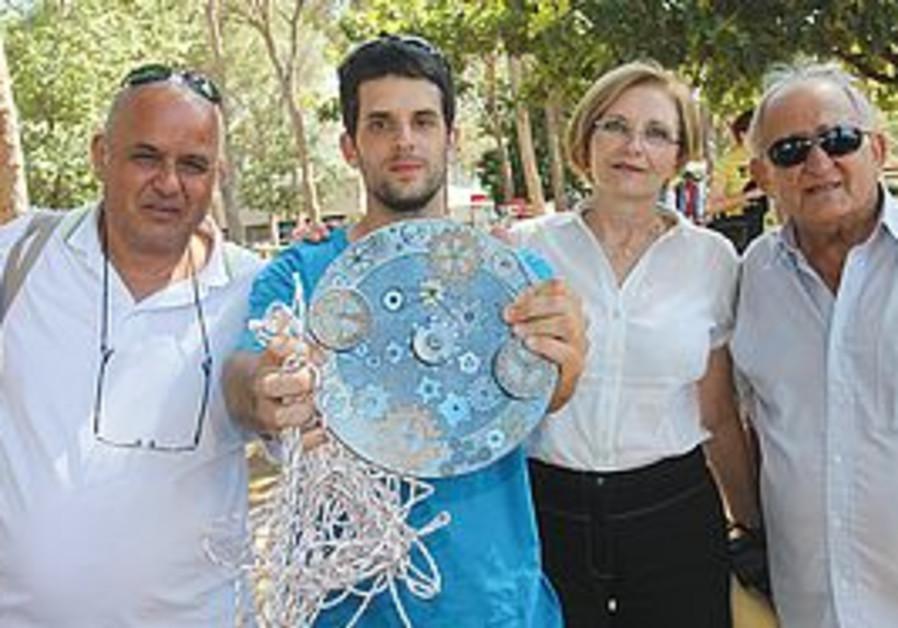 EYAL MOSHE COHEN shows off his winning yo-yo