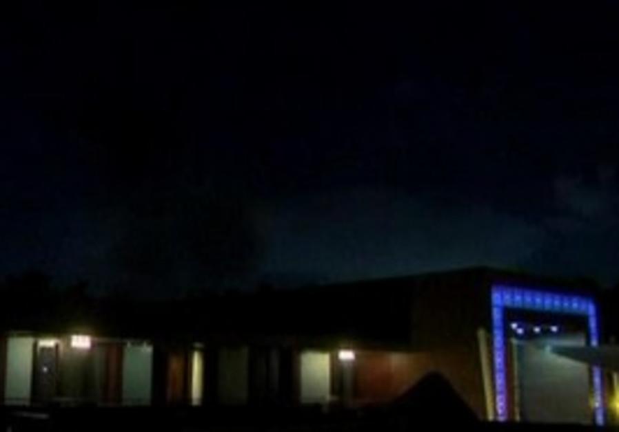 Smoke rising above the Gaddafi compound