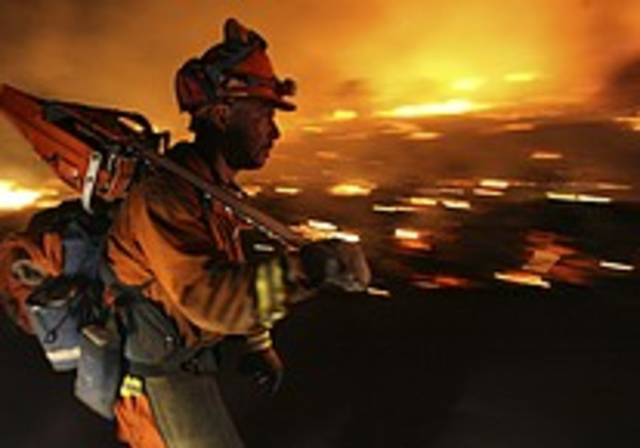 Fire losses top $1 billion, Bush signs disaster declaration