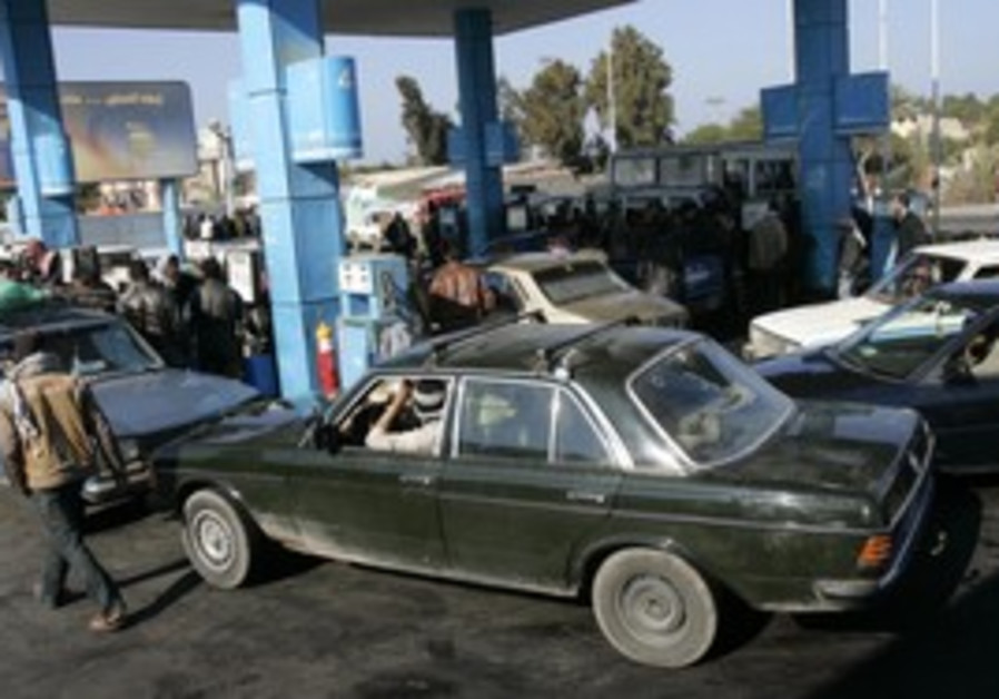 Gazans buy gasoline in Rafah