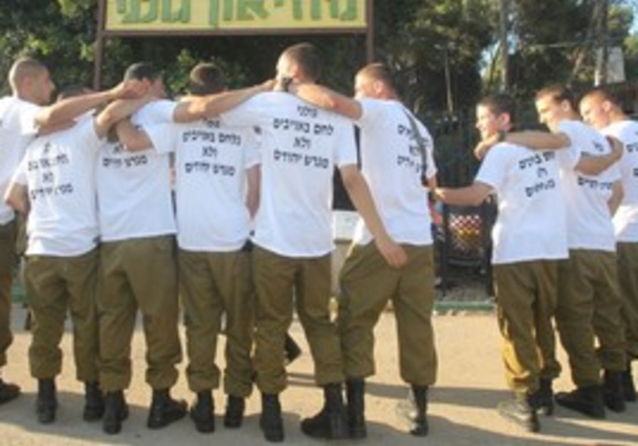 Golani soldiers wearing settlement shirts