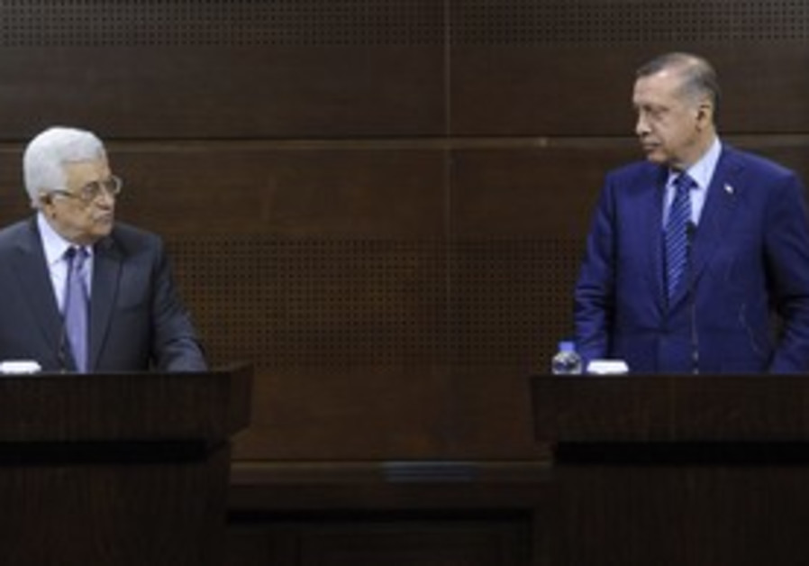 Abbas (L) and Erdogan in Ankara, Friday.