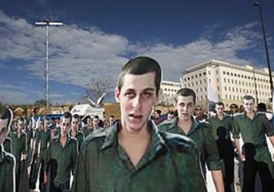 Cardboard cutouts of Schalit at a 2009 rally
