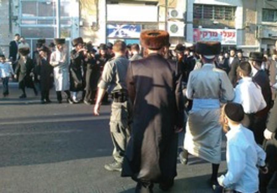 haredim stand in street