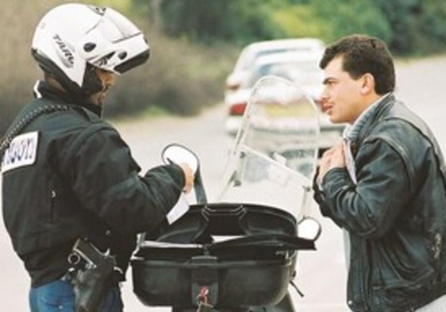 Police officer gives motorist a traffic ticket