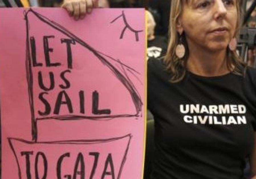 Activist holds placard during flotilla briefing