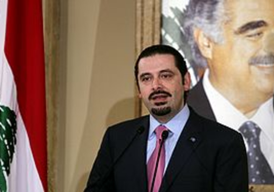 Sa'ad Hariri in front of his father's picture