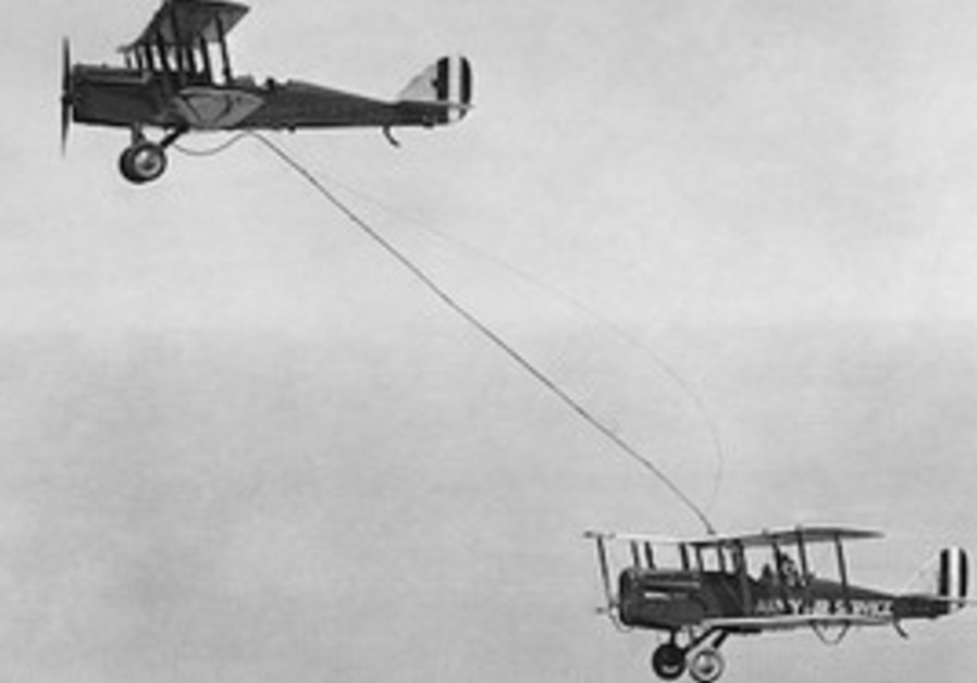 One of the first mid-air refueling attempts