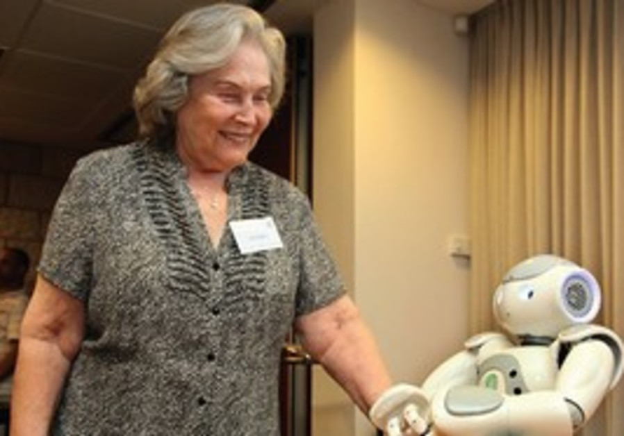 Prof. Ruth Arnon with a robot