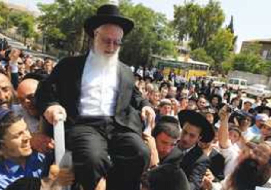 SUPPORTERS CARRY Rabbi Ya'acov Yosef near his home