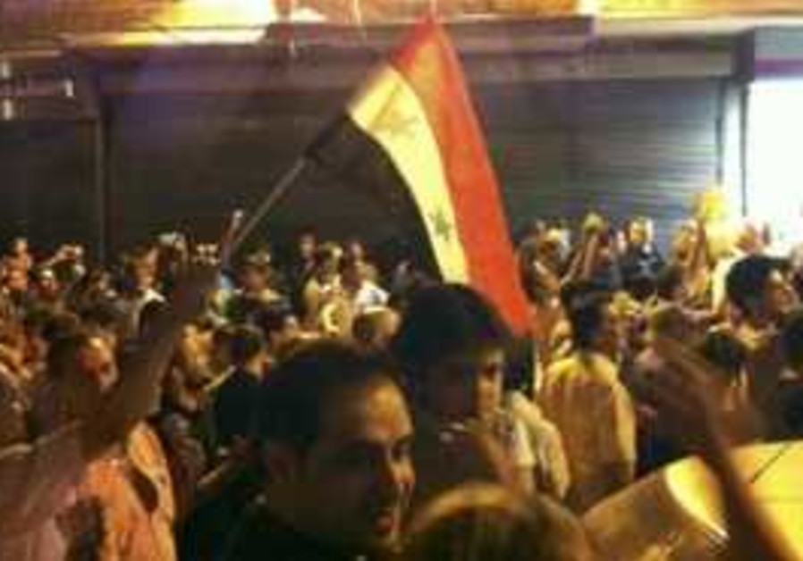 Protesters take part in demo against Assad