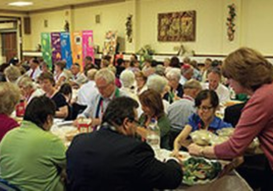 Jews and Methodists enoy their mock seder, Monday.