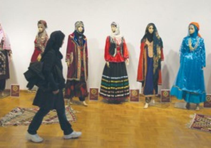 Iranian student walks past mannequins