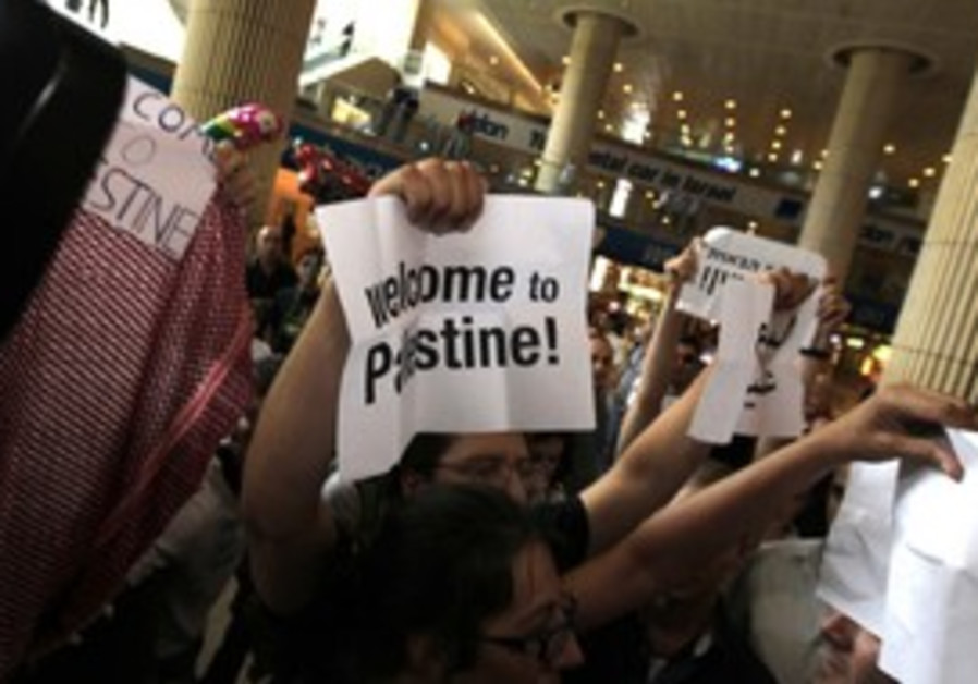 Israeli activists protest at B-G airport, Friday.