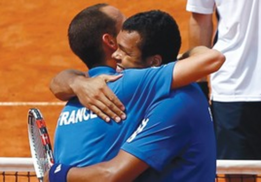 GILLES SIMON and Jo-Wilfried Tsonga yesterday.