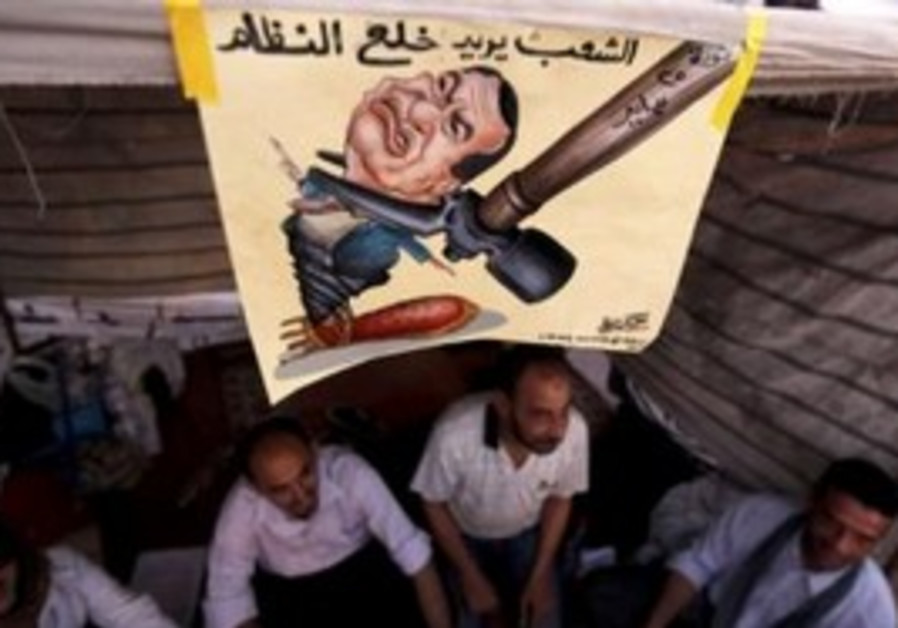 Protesters sit in Tahrir Square