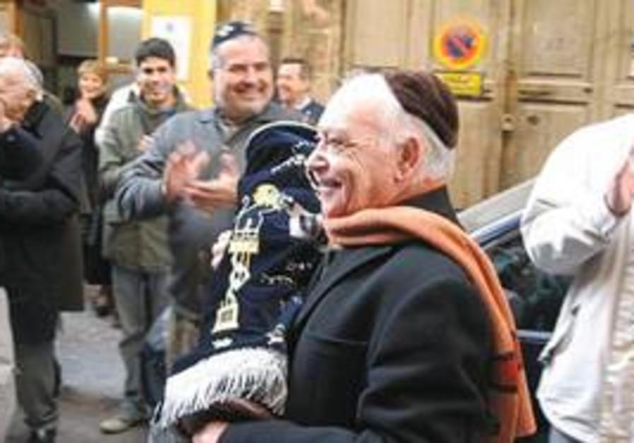 Man dances with the Torah in Palma de Majorca