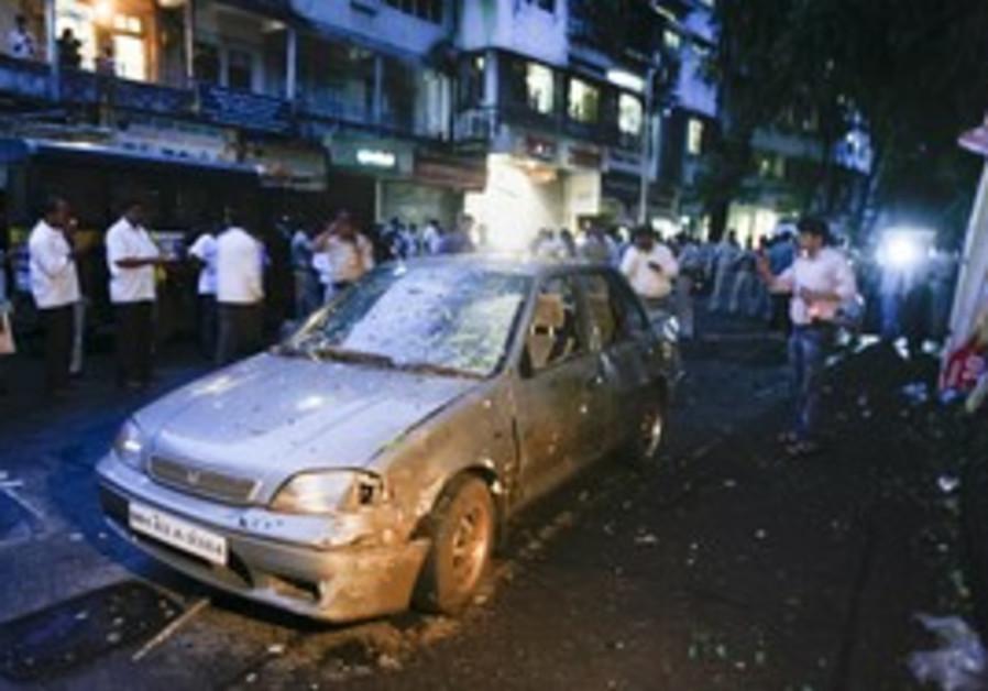 A damaged car at the Dadar area of Mumbai, Weds.