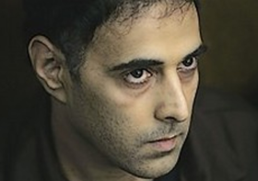 State considers easing Yigal Amir's prison conditions