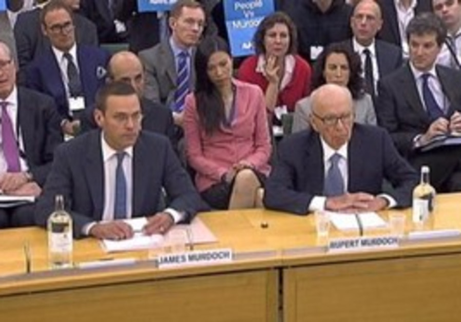 Murdochs stand before the British Parliament.