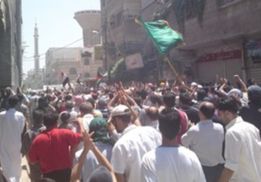 Demonstrators march through streets in Damascus.