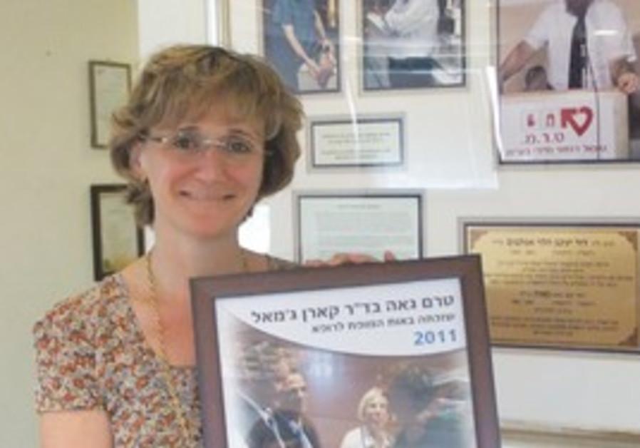 Dr. Karen Djemal with her award